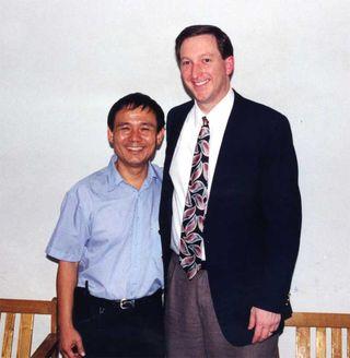 Todd with Pastor Li De-Xian in 1999.
