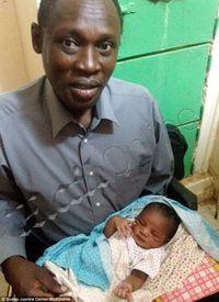 Daniel Wani and child
