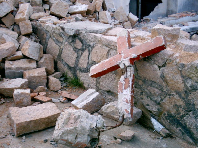 The bulldozered House (church) of sha Ao-4 with a damagedcross copy